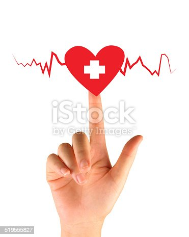 istock Hand pressing button with first aid sign 519555827