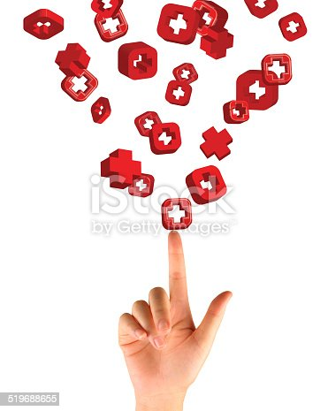 istock Hand pressing button with first aid sign 519688655