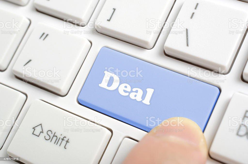 Hand pressing deal key royalty-free stock photo