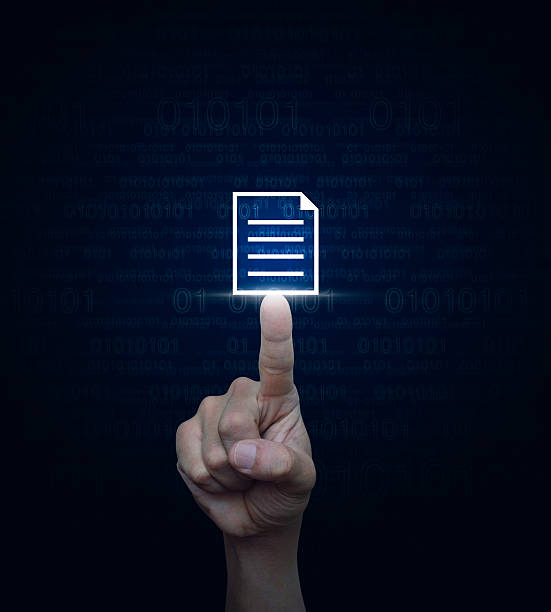 Hand pressing document icon over computer binary code blue background stock photo