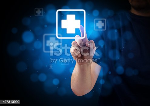 High detailed technology background with hand pressing first aid virtual button