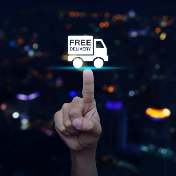 Hand pressing free delivery truck icon stock photo
