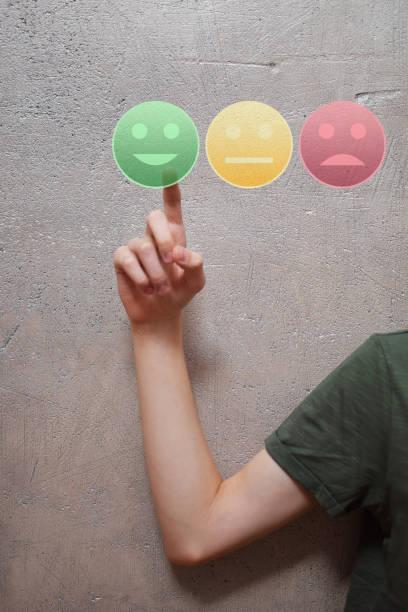 hand pressing happy face button - feedback icon imagens e fotografias de stock