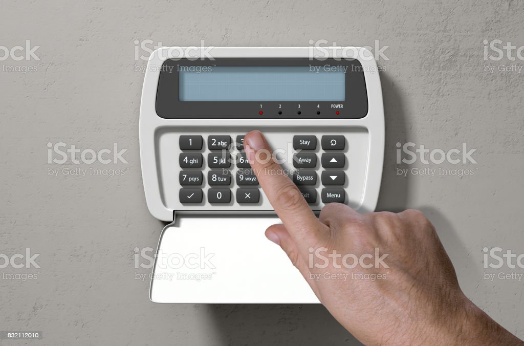 Hand Pressing Home Security System stock photo