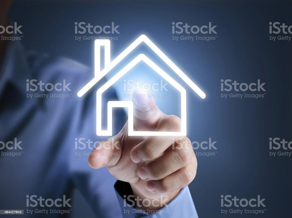 Hand pressing house stock photo