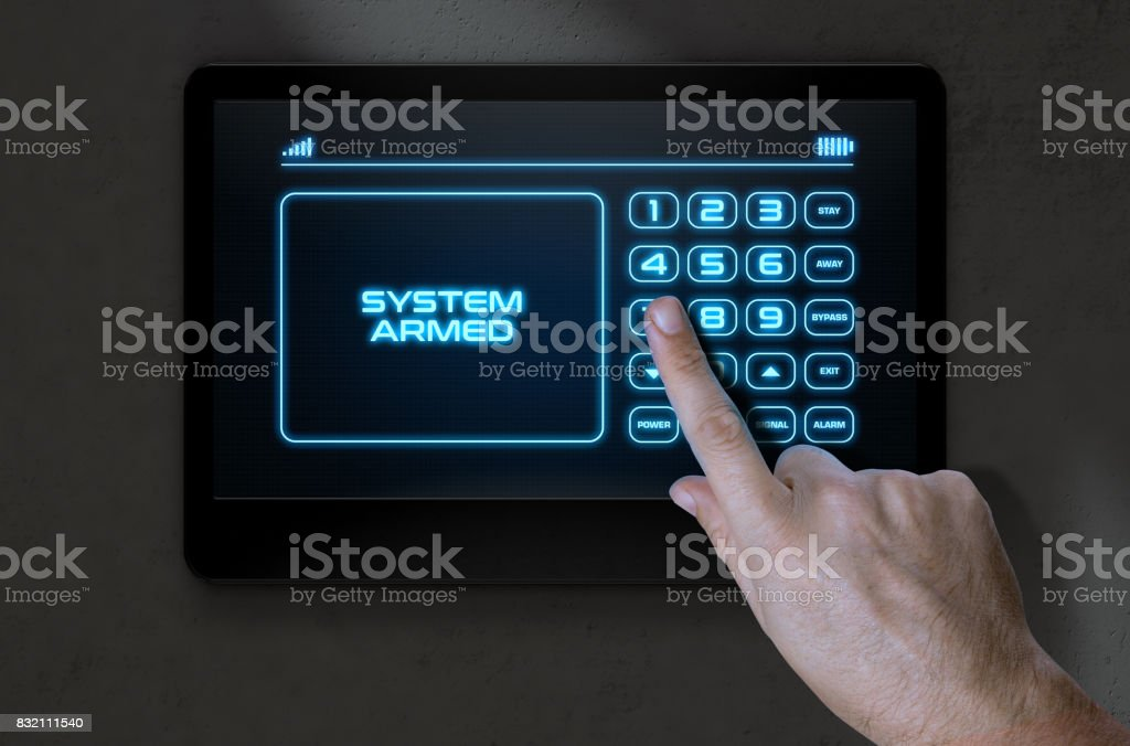 Hand Pressing Modern Home Security stock photo