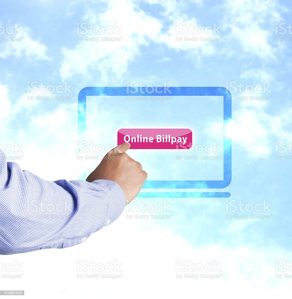 Hand pressing online billpay button stock photo