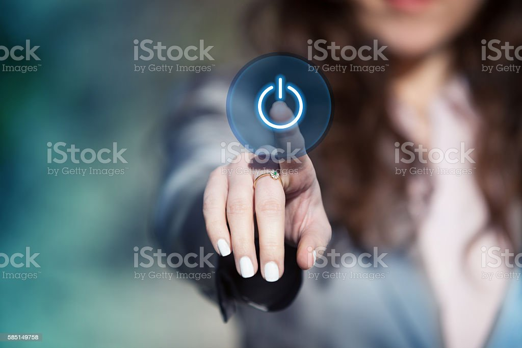 Hand pressing power button on touch screen. – Foto