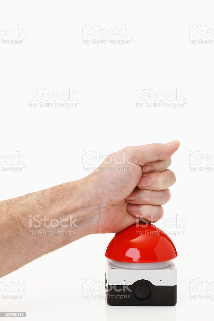 Hand pressing red game show buzzer stock photo