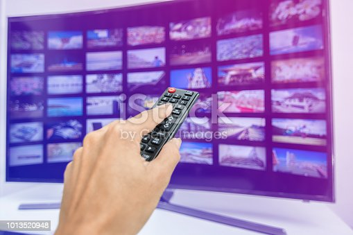 istock Hand pressing remote of smart tv 1013520948