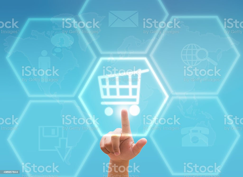 hand pressing shopping cart on a touch screen interface stock photo