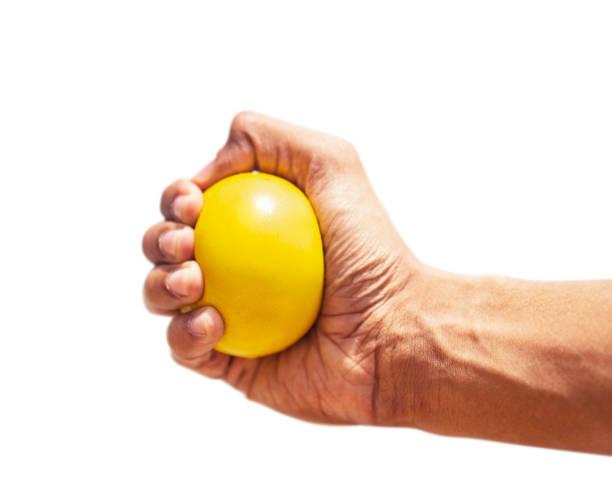 Hand Pressing Stress Ball stock photo