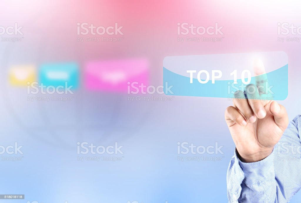Hand pressing top 10 button stock photo