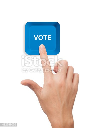 female hand pushing Vote keyboard button on white background
