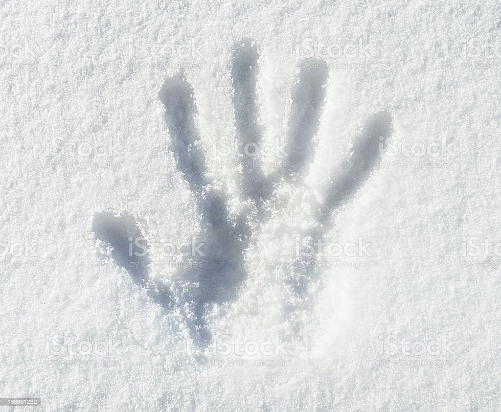 Hand Print in Snow stock photo
