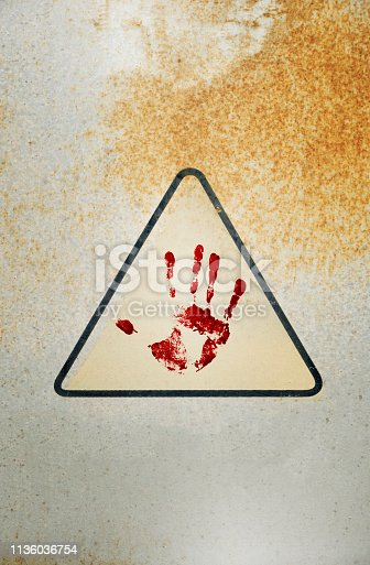 istock hand print on wall background 1136036754