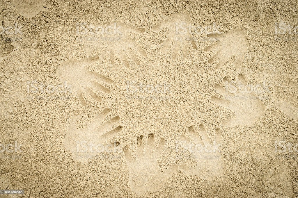 Hand prints in the sand stock photo