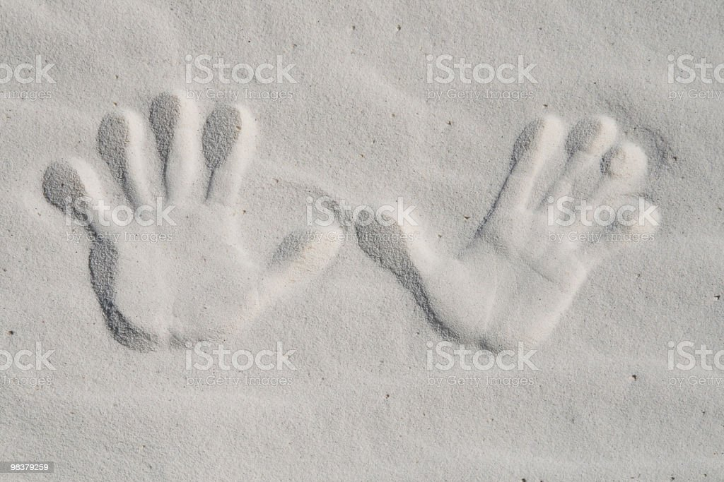 Hand prints in white sand royalty-free stock photo