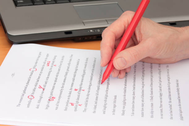 Hand proofreading a manuscript beside laptop picture id1150422011?b=1&k=6&m=1150422011&s=612x612&w=0&h=y 4ekefc0mvj2j5p1eeigw9nbths4uddj4fglai7l5o=