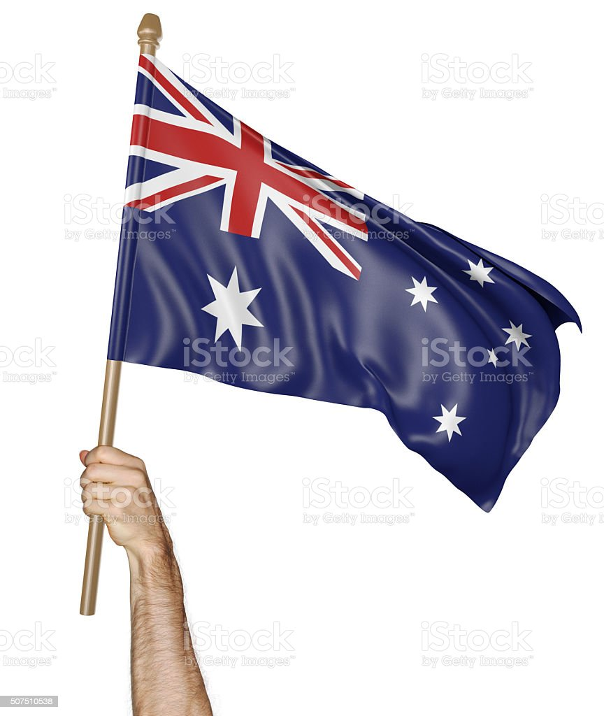 Hand proudly waving the national flag of Australia stock photo
