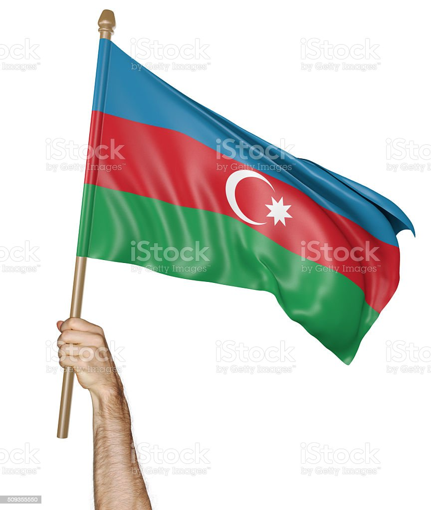 Hand proudly waving the national flag of Azerbaijan stock photo