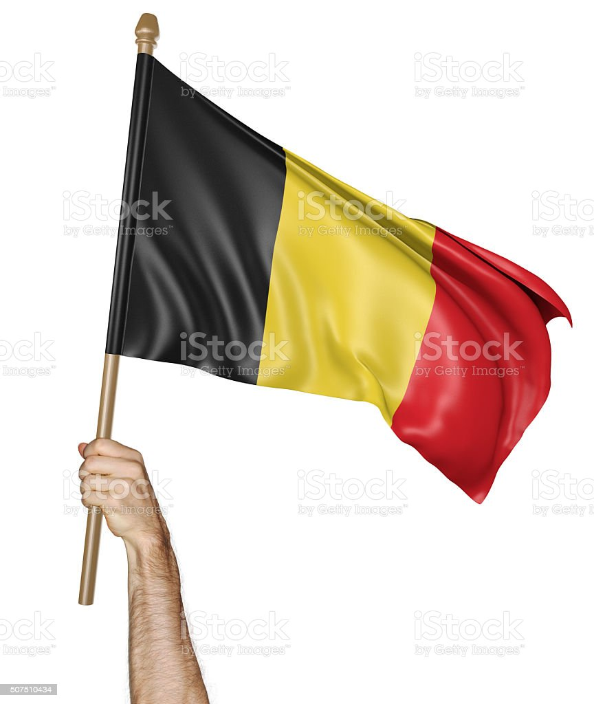 Hand proudly waving the national flag of Belgium foto