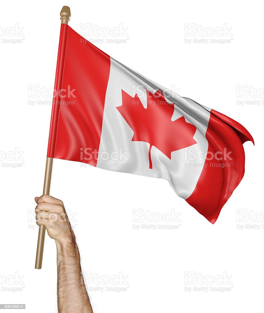 Mão orgulhosamente acenando a bandeira nacional do Canadá - foto de acervo