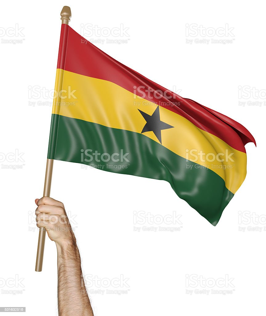 Hand proudly waving the national flag of Ghana stock photo