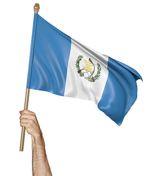 Agitando la mano con orgullo la bandera de Guatemala - foto de stock