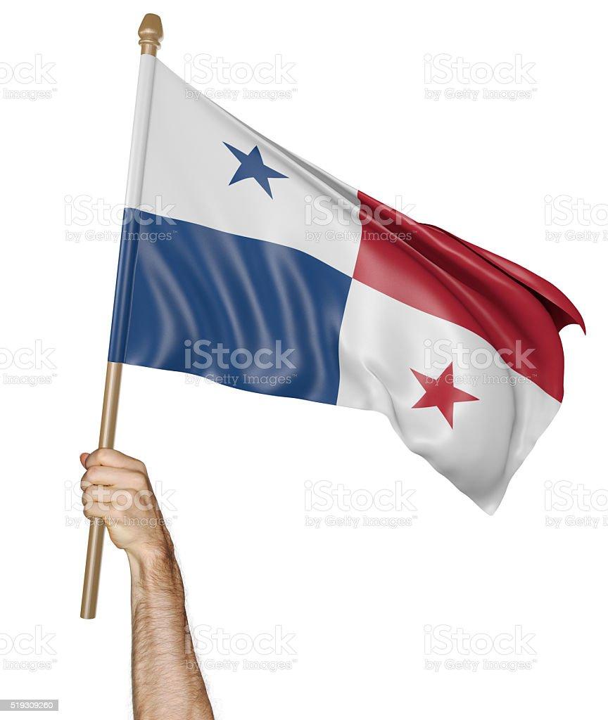 Mão orgulhosamente acenando a bandeira nacional do Panamá - foto de acervo