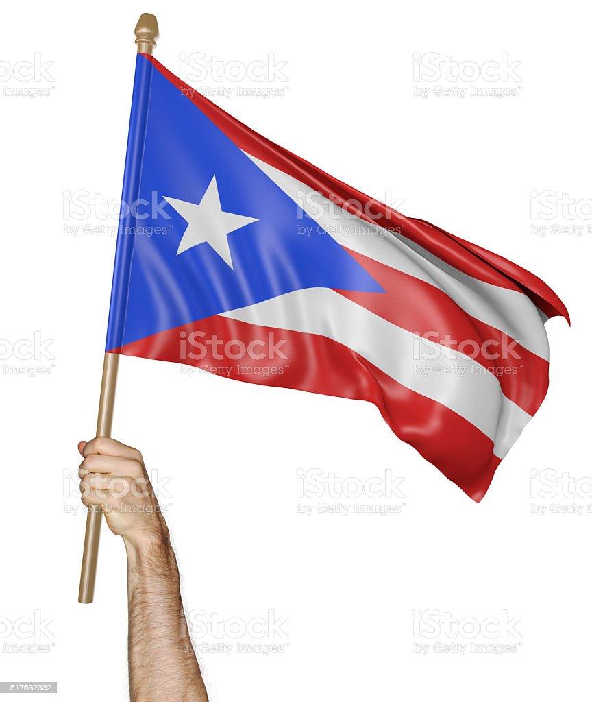 Agitando la mano se enorgullece de bandera nacional de Puerto Rico - foto de stock