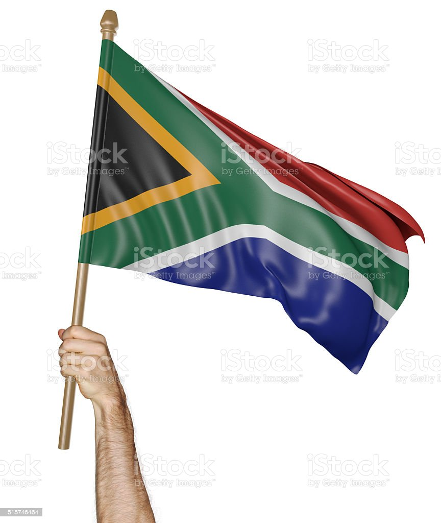 Hand proudly waving the national flag of South Africa stock photo