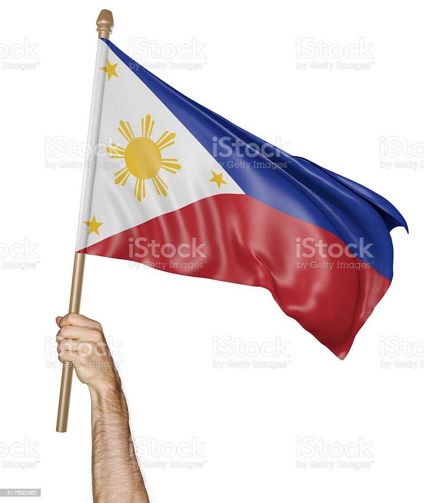Hand proudly waving the national flag of the Philippines stock photo