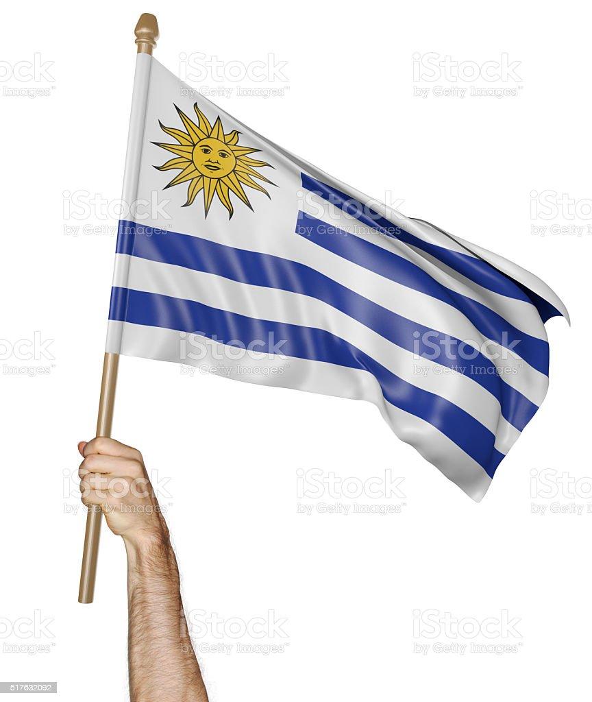 Agitando la mano con orgullo la bandera de Uruguay - foto de stock