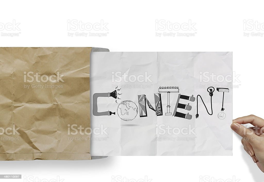 hand pulling crumpled paper from envelope with design word CONTE stock photo