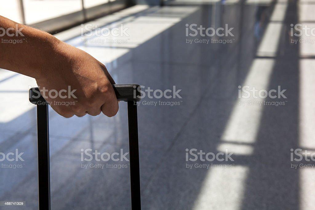 Hand Pulling Luggage stock photo