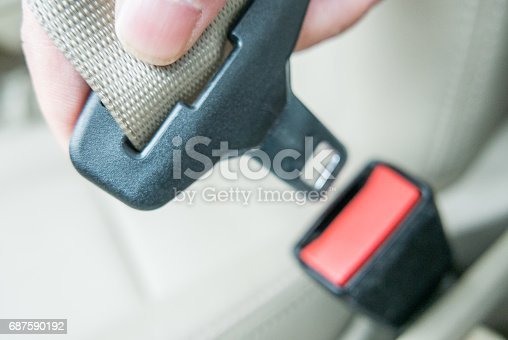 istock Hand pulling seat belt 687590192