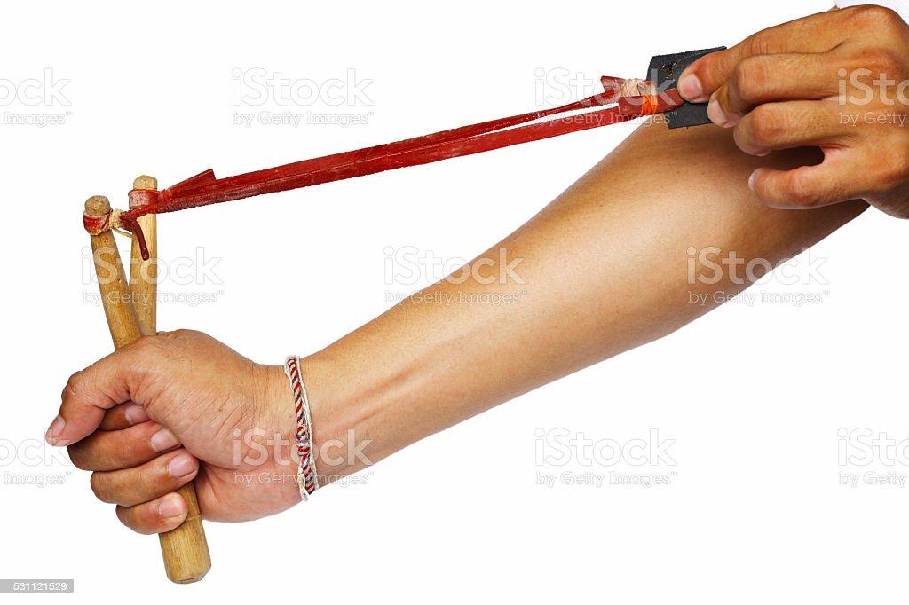 Hand Pulling Slingshot on White Background stock photo
