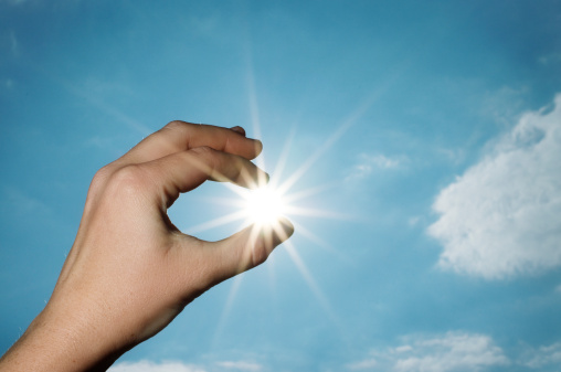 istock Hand pulling the sun from sky 115244888