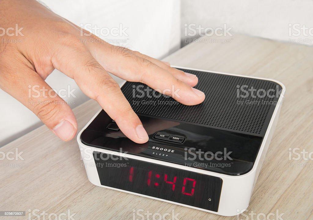 Hand push an alarm clock stock photo