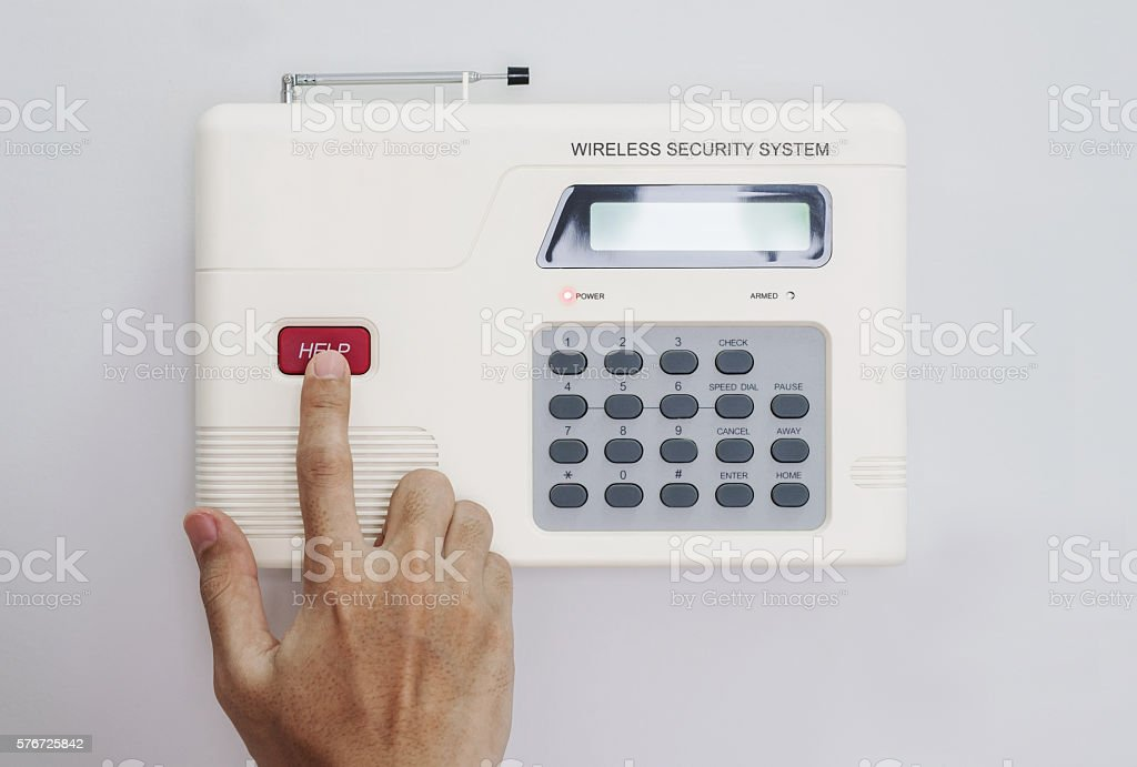 Hand push button of home security system stock photo