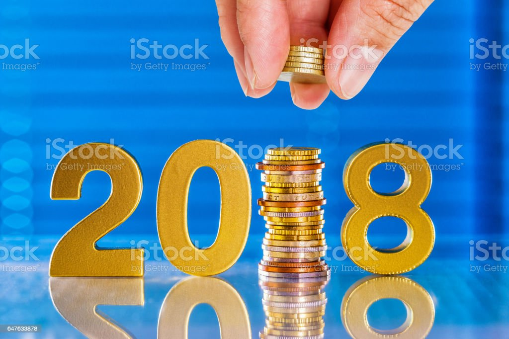 hand push the euro coin in to 2018 stock photo