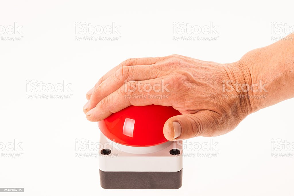 Hand pushing a red buzzer stock photo