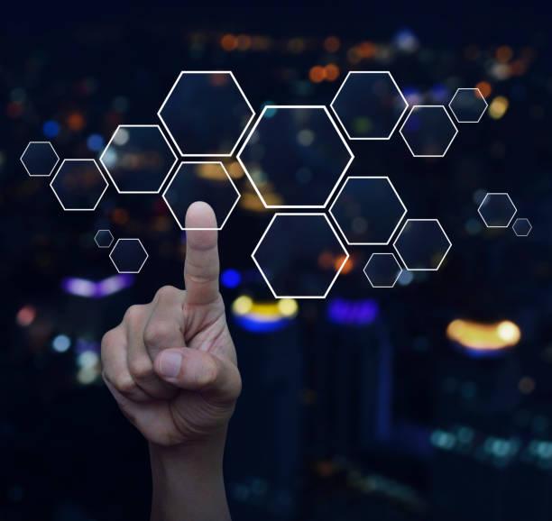Hand pushing blank hexagon shape virtual technology screen stock photo
