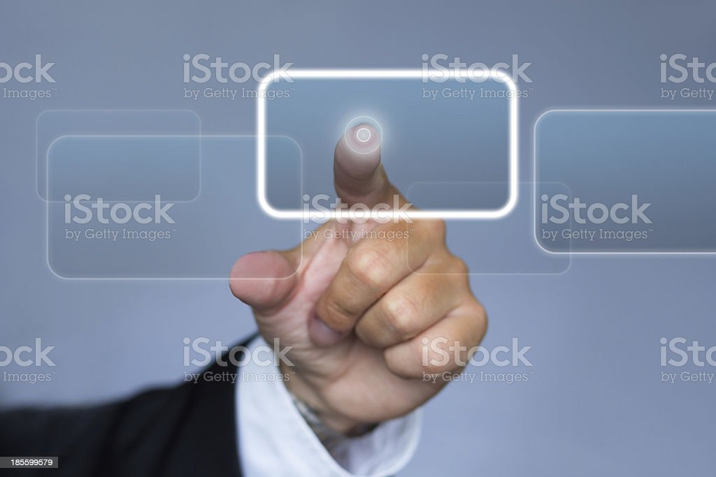 Hand pushing button on touch screen royalty-free stock photo