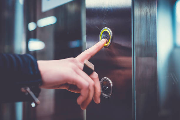 hand pushing elevator button - button stock photos and pictures