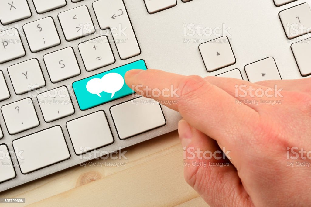 Hand Pushing Message Button on Keyboard stock photo