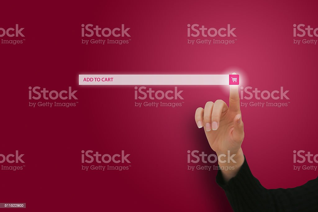 Hand Pushing Shopping Button on Touch Screen stock photo