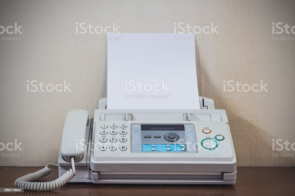 hand pushing start button old fax retro style stock photo