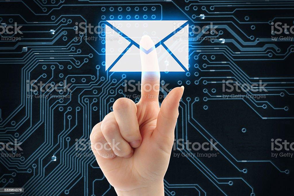 Hand pushing virtual mail button stock photo